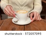 close up female hands holding... | Shutterstock . vector #572057095