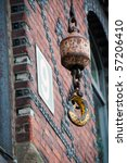 Crane hook in front of old red bricked warehouse in traditional Hamburg Speicherstadt (harbour district) - stock photo