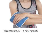 woman putting an ice pack on...   Shutterstock . vector #572072185
