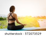 young fitness woman practicing... | Shutterstock . vector #572073529
