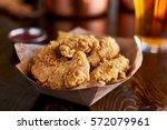 basket of tasty fried chicken... | Shutterstock . vector #572079961