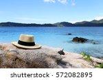 Hat On Rocks Beach Background.