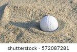 golf ball in sand trap   Shutterstock . vector #572087281