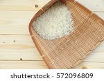 rice on wood background | Shutterstock . vector #572096809