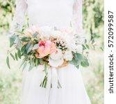 beauty wedding bouquet in bride'...   Shutterstock . vector #572099587