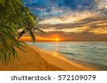 sunrise in a caribbean beach | Shutterstock . vector #572109079
