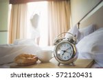 alarm clock  cup of coffee and...   Shutterstock . vector #572120431