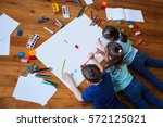 children draw together on a... | Shutterstock . vector #572125021