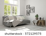 white room with sofa and green... | Shutterstock . vector #572129575