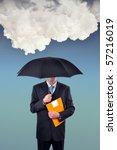 Insurance agent holding umbrella under huge rainy cloud - stock photo