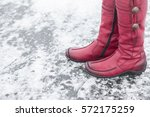 woman walking on the lake ice... | Shutterstock . vector #572175259