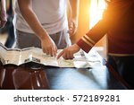 tourists and hotel staff are... | Shutterstock . vector #572189281