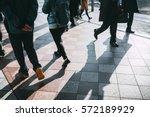 people walking in the street  ... | Shutterstock . vector #572189929