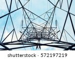 high voltage towers on skies... | Shutterstock . vector #572197219