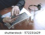 man hand using voip headset... | Shutterstock . vector #572231629