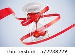 hourglass in the form of hearts.... | Shutterstock . vector #572238229