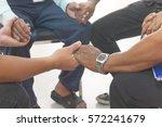 group of different men praying... | Shutterstock . vector #572241679