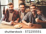 handsome friends are drinking... | Shutterstock . vector #572255551