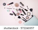 a blue make up bag with... | Shutterstock . vector #572260357