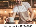 cropped image of handsome... | Shutterstock . vector #572262049