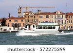 Small photo of ITALY. VENICE - APRIL 22, 2016: Pleasure boat floating on a background of old city architecture. Venice is situated on the northern Adriatic coast.