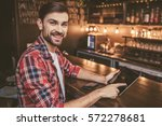handsome man is using a digital ... | Shutterstock . vector #572278681
