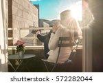 Woman Drinking Coffee Under Sun ...