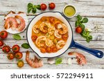 fried shrimp with tomatoes and... | Shutterstock . vector #572294911