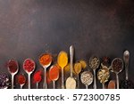 various spices spoons on stone... | Shutterstock . vector #572300785