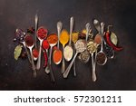 various spices spoons on stone... | Shutterstock . vector #572301211