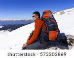hiking in the mountains in the... | Shutterstock . vector #572303869