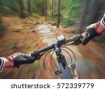 ride on bicycle on road in... | Shutterstock . vector #572339779