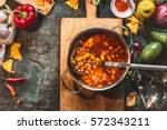 vegetarian bean soup in cooking ... | Shutterstock . vector #572343211