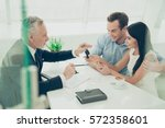 real estate agent working with... | Shutterstock . vector #572358601