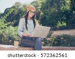 happy hipster young woman... | Shutterstock . vector #572362561