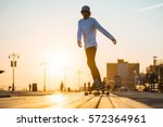 young skaterboy riding...   Shutterstock . vector #572364961