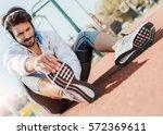 handsome sportsman doing... | Shutterstock . vector #572369611