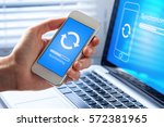 mobile phone synchronizing data ... | Shutterstock . vector #572381965