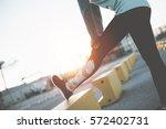 woman doing legs stretching.... | Shutterstock . vector #572402731