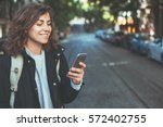 handsome smiling woman with... | Shutterstock . vector #572402755