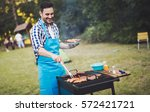 handsome  happy male preparing... | Shutterstock . vector #572421721