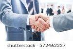 closeup of handshake as a sign... | Shutterstock . vector #572462227