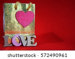 valentines day gift bag with... | Shutterstock . vector #572490961