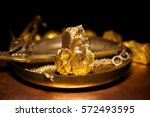 closeup of big gold nugget and... | Shutterstock . vector #572493595