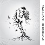 silhouette of lovers in a tree | Shutterstock .eps vector #572494987