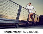 athletic woman running during...