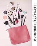 a pink leather make up bag with ... | Shutterstock . vector #572541964