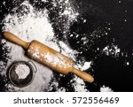 metal strainer and rolling pin... | Shutterstock . vector #572556469