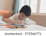 an asian kid painting color in... | Shutterstock . vector #572566771