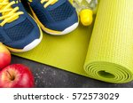 yoga mat  sport shoes  apples ... | Shutterstock . vector #572573029